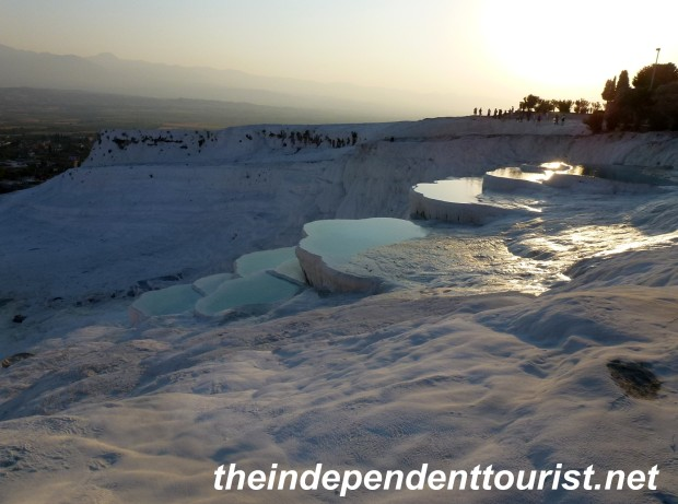 The setting sun reflecting on the travertine pools.