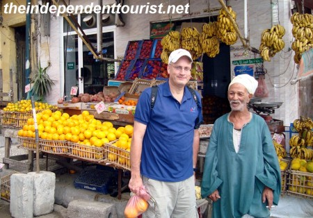 Purchasing some fruits from a street vendor (great oranges!).
