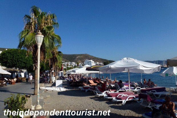 The beaches of Bodrum, right next to many restaurants and shops.