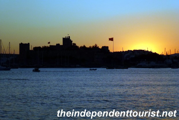 The sun sets over St. Peter's castle in Bodrum.