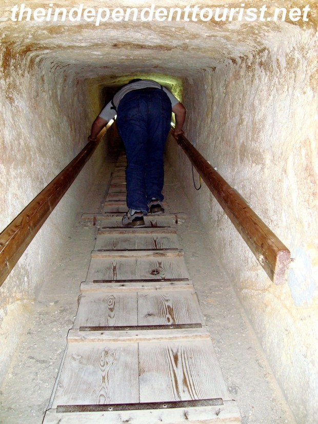 Climbing out of the Queen's Pyramid, giving an idea of what the access tunnels are like.