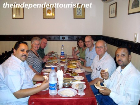 Eating dinner with our driver (on left) and his colleague after a day of touring Cairo.