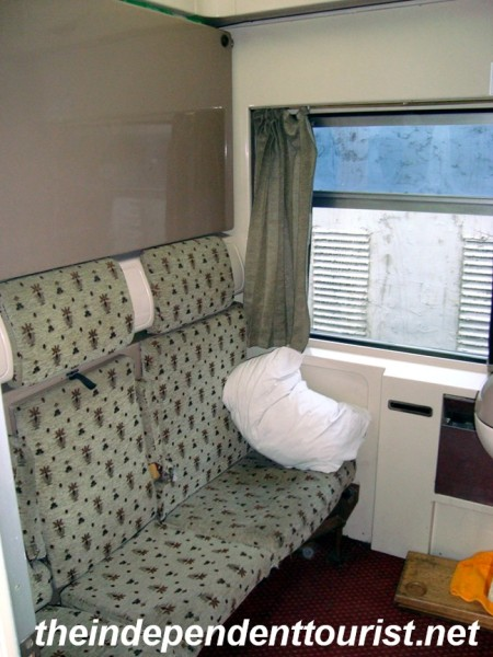 Interior of a train sleeper cabin. (A bed folds down above the seats).