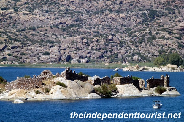 Byzantine monastery ruins on a rock island just offshore in Lake Bafa.