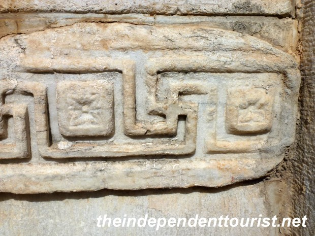 A swastika at the Temple of Hadrian, a common symbol in classical Mediterranean times.