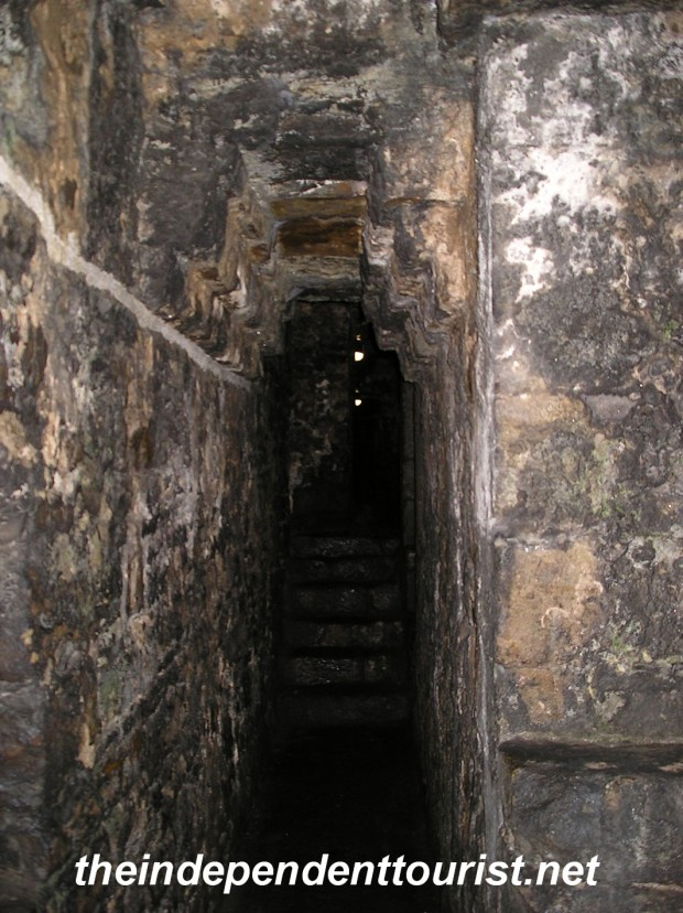 One of the many dark corridors in the walls of Beaumaris Castle.