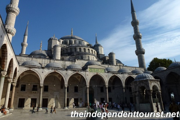 The courtyard of the Blue Mosque. The courtyard is about the same size as the Mosque itself. Note the cascade of domes above the courtyard.