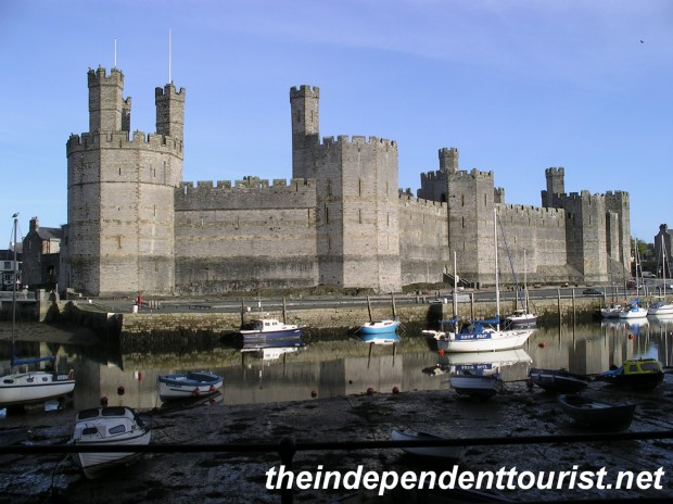 A view of Caernarfon Castle from across the River Seiont.