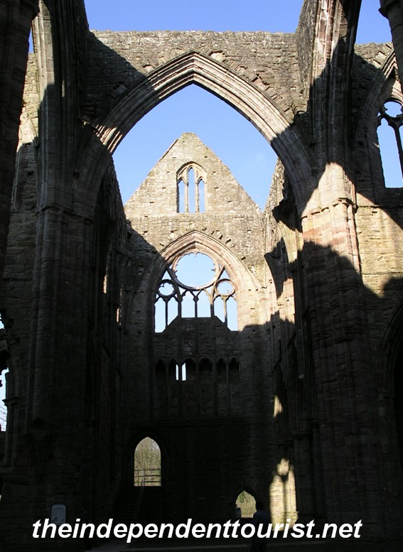 Another interior view of Tintern Abbey, note the fine window detail.