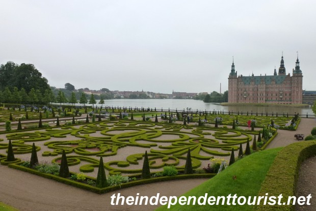 A view of Fredriksborg castle, lake and gardens.