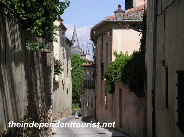 One of the narrow lanes in the old city of Segovia - the Alcazar lies ahead.