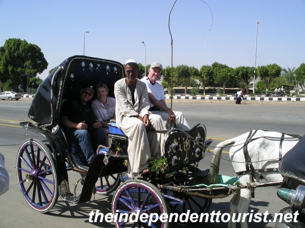 My sister, brother in-law and father in-law taking a ride from Luxor to Karnak.