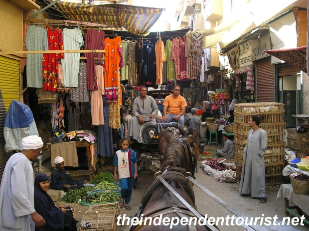 Taking a carriage ride through the markets of Luxor.
