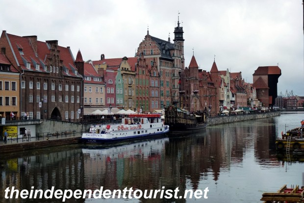 The waterfront of Gdansk. At the far right is the Gdansk Crane, a medieval crane that used people in huge wheels (like hamsters) to power the crane and load or unload ships.