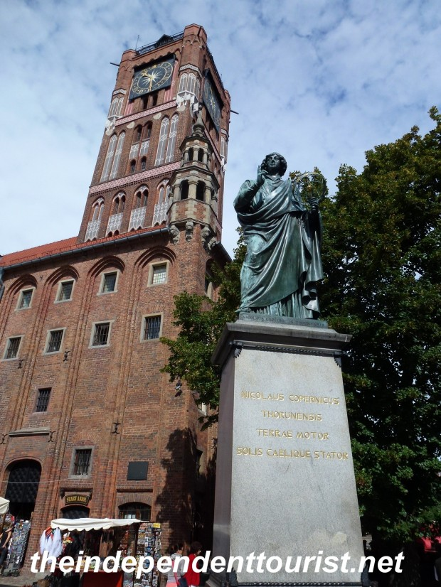 Statue of Copernicus and the Town Hall tower, which you can climb for great views.
