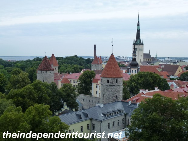 View of Tallinn's walls and towers from Toompea Hill. St. Olav's Church has the tall spire on the right.
