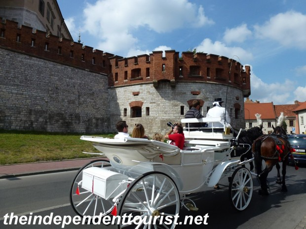 A great way to see Wawel Castle's exterior is by a carriage ride.