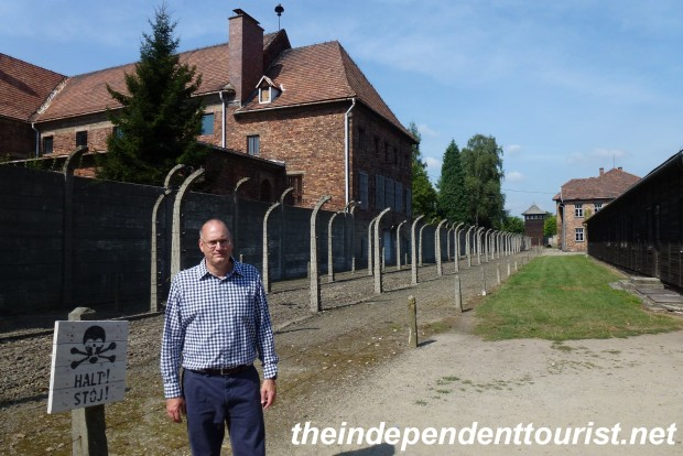 One of the fence lines at Auschwitz I. The building behind me was where the confiscated belongings of the prisoners were kept, along with the supplies of the poison gas.