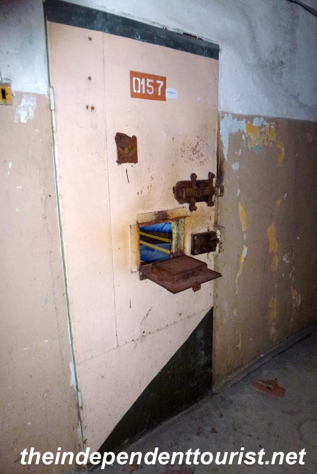A cell door with a small opening for sliding food to the prisoner.