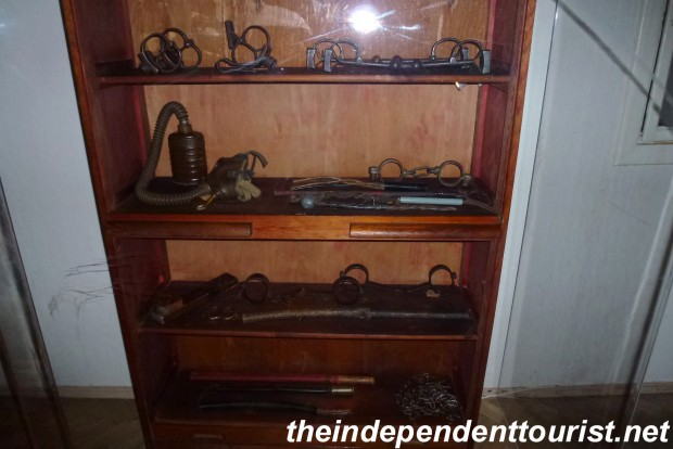 A display of various interrogation/torture devices.