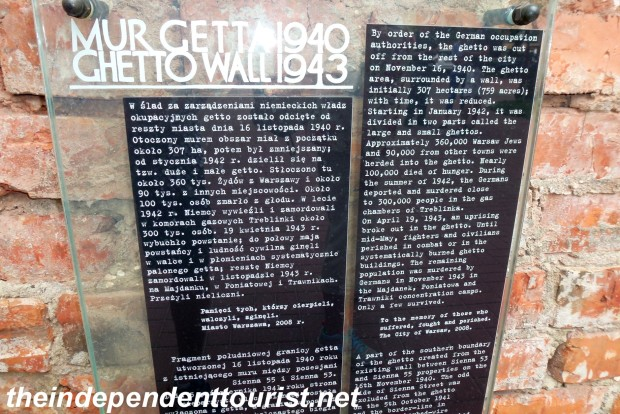 Information about the Warsaw Ghetto is posted on the wall.