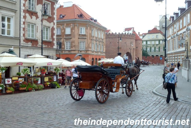 A horse-drawn carriage on a street in Old Town Warsaw.