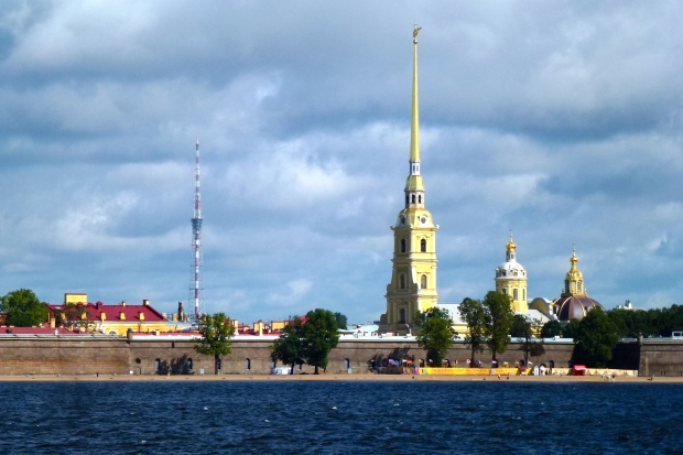 A view of the Peter & Paul Fortress from the Neva River. This fortress was built to protect the city from Swedish attack and was used for holding political prisoners. The tall spire and tower identify  the Sts. Peter and Paul Cathedral.