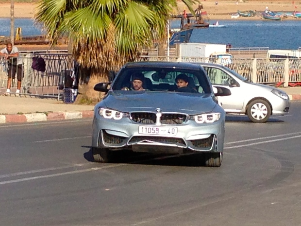 Tom Cruise at the wheel with Simon Pegg next to him, filming in Rabat.