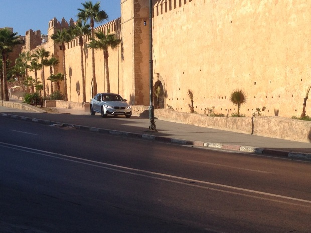 Although hard to tell, that's Tom Cruise racing the BMW (with Simon Pegg as a passenger) in a shot right by the Kasbah. It will be interesting to see if this scene makes it into the movie. They shot this scene several times.