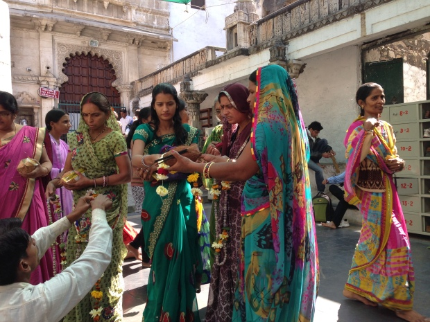 Women purchasing flower offerings prior to entering the Eklingji temple complex.