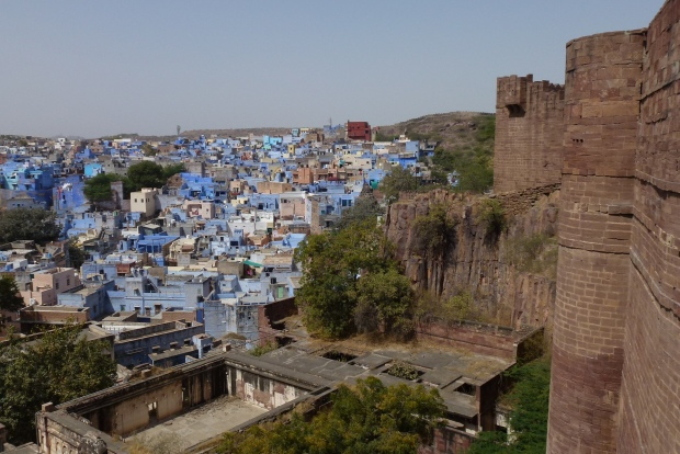 The blue buildings near the fort's north side.