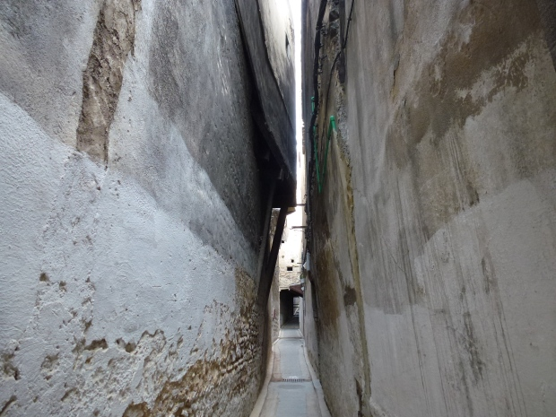 The buildings are almost touching in this narrow Fez Medina alleyway.