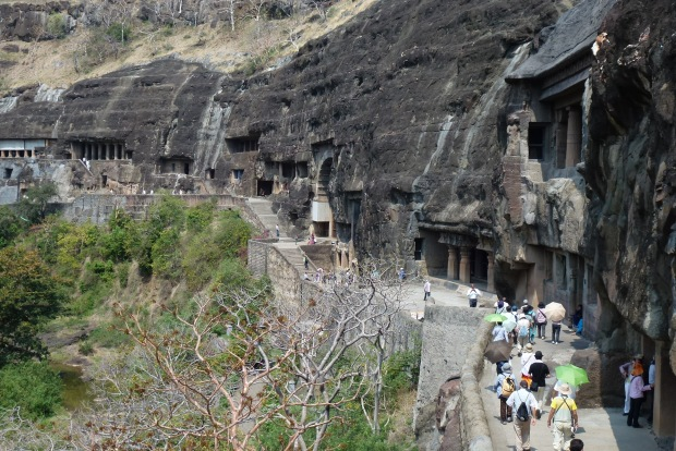 A view of the path to the Ajanta Caves - you can see how they are carved into the rock face. Some entrances are more elaborately carved than others.