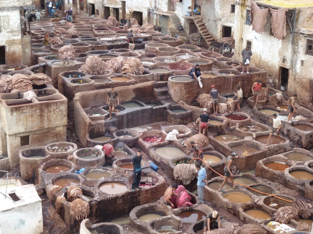 A closer look at the Chouwara Tanneries. The workers are constantly moving from vat to vat to keep the skins moving through the process.