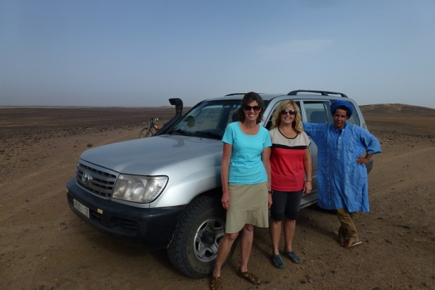 Our driver with our wives. He was very helpful and provided a good overview of the area.