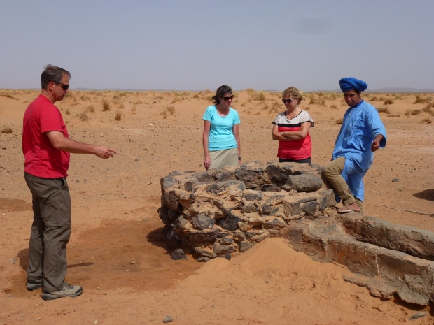 A well. Surprisingly, the water table is pretty high - water is found just a few feet below the dunes!